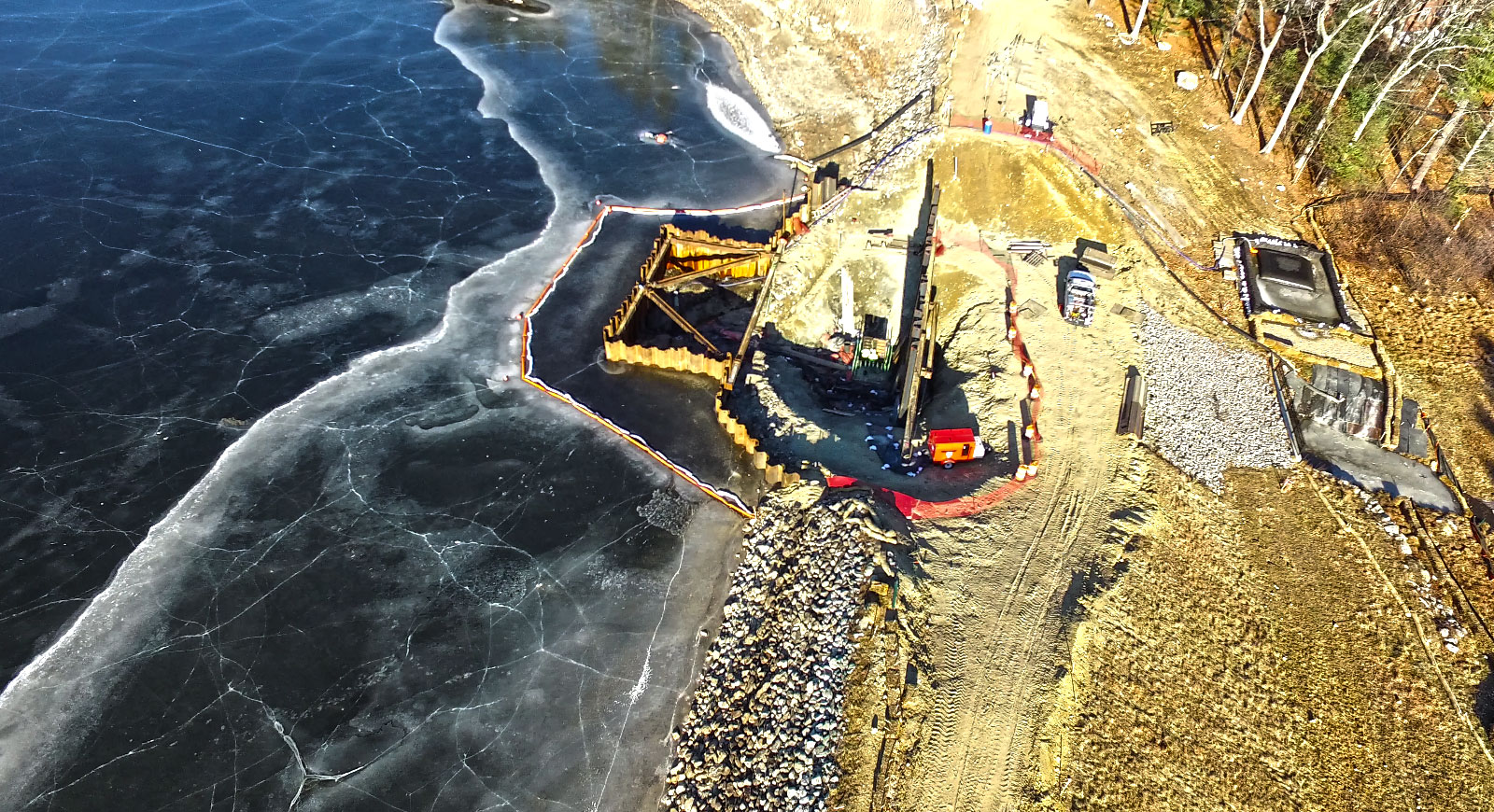 overhead view of construction site next to body of water