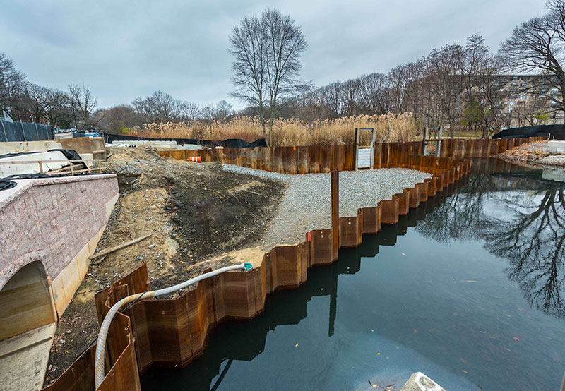 construction site next to body of water at Muddy River Flood Risk & Restoration Project