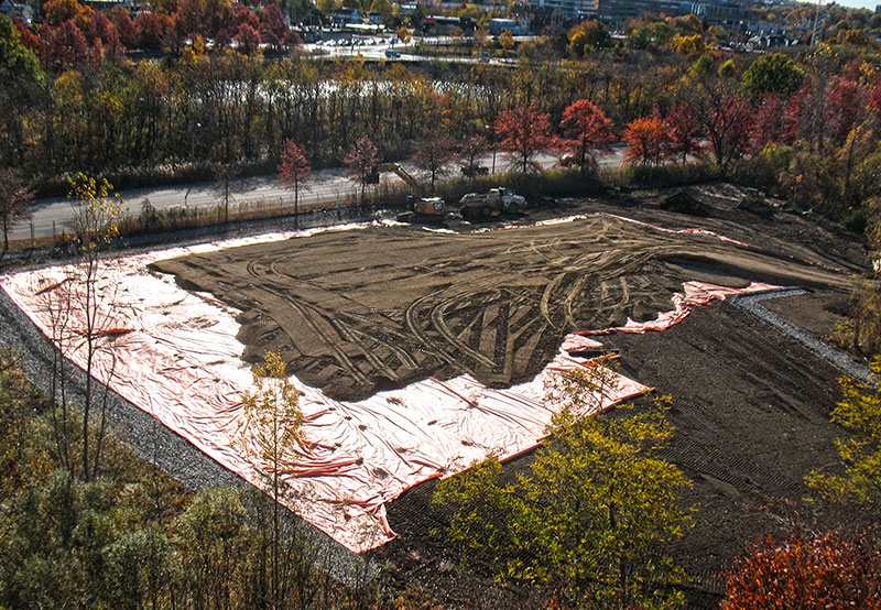 overhead view of large dirt pile over tarp at Project Test 4 3 site